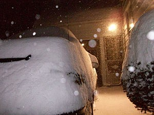 Snow Covered Car in West Utica