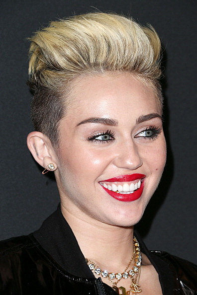 Miley Cyrus Gold Tooth MySpace Event