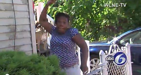 woman throwing a rock at cameraman