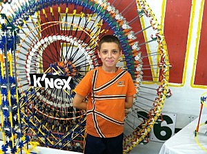 Dylan Grems with his ferris wheel.