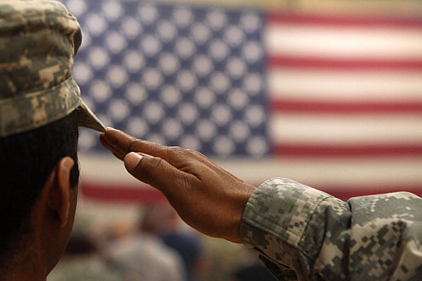 US soldier saluting our flag