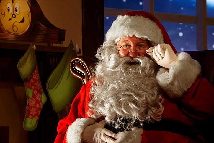 close up of happy Santa holding his glasses