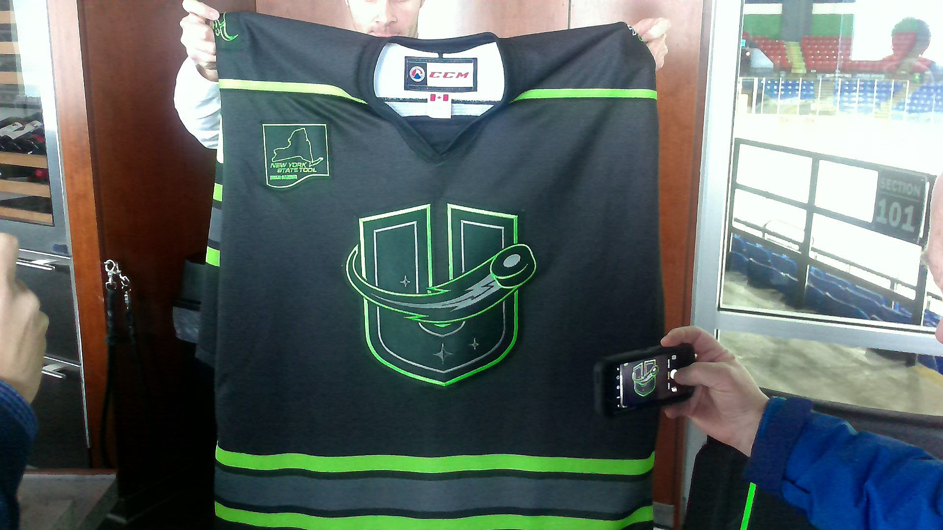 The Utica Comets' Black and Neon Green Uniforms for 'Save of the Day' Night