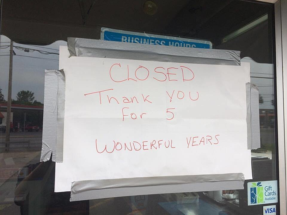 Sign Posted Over the Business Hours at John's Pizzeria in Marcy